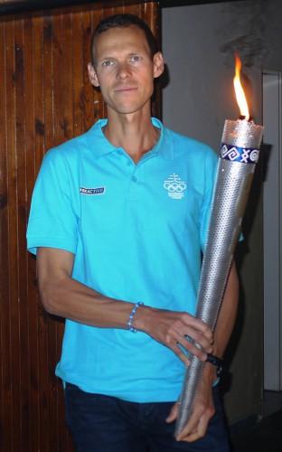 Matej Toth s olympijskou faklou
